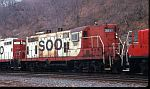 Rusty Soo 381 passes on a freight