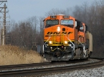 Westbound CSX E942 is led by bnsf 6182 on track number one at QD CP163