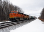 BNSF 6359 leads Eastbound CSX Q380 at MP QD124 on track number two.