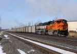 BNSF 9151 and 9621 lead Eastbound CSX N886 at MP QD125 on track number three.