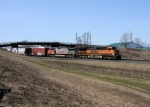 BNSF 970 leads Eastbound CSX Q380 at MP 70 on track number two.