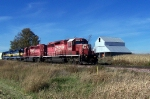 CP 5965 leads past a classic farm structure