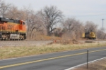 BNSF 6759 Waits On Siding As The Morning Beer Train Passes