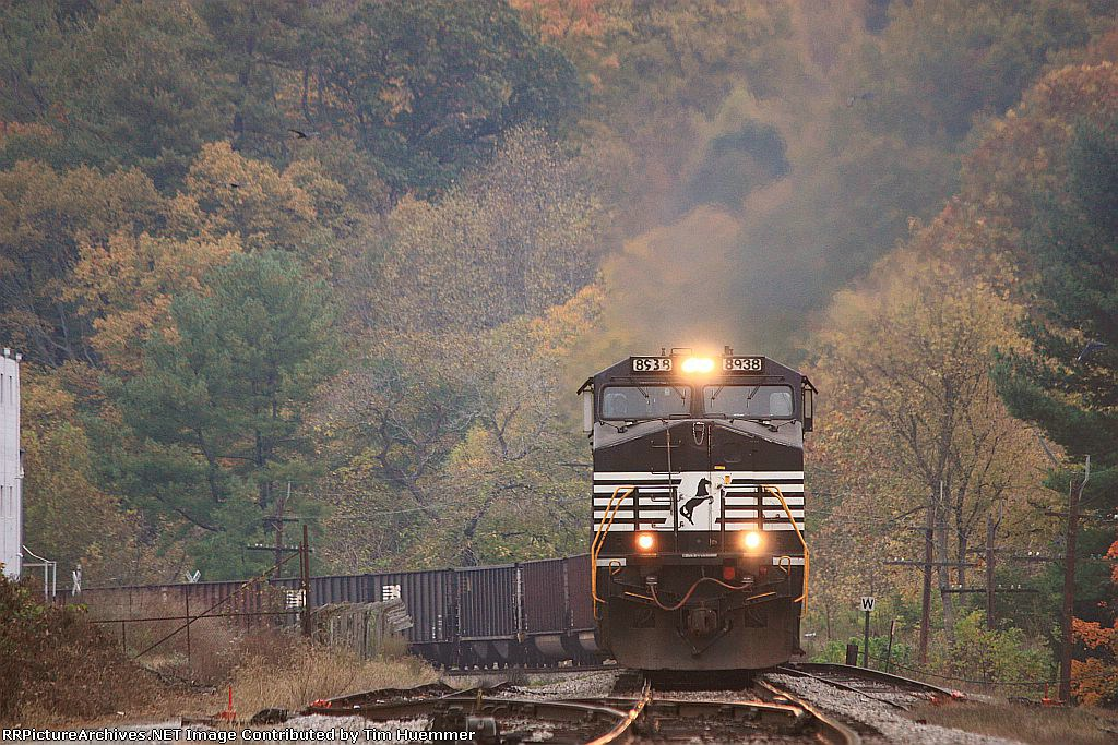 Northbound coal drags up the hill