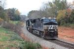 Loaded coal train rumbles past