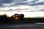 G620 picks up long grain train from RJ Corman line