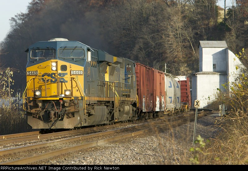 CSX 5449 leads a westbound by the old MFA grain elevator at Morrison, MO