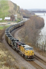 UP 6768 rolls eastbound coal buckets along the Missouri River