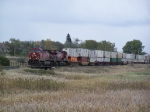 CP 9640 Speeds Past Town with a Train of Intermodal Containers