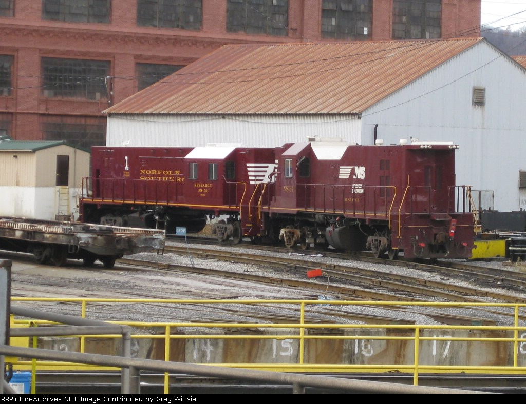 Both of Norfolk Southern's Track Test Units are sitting on shop trucks near the Juniata Shops turntable