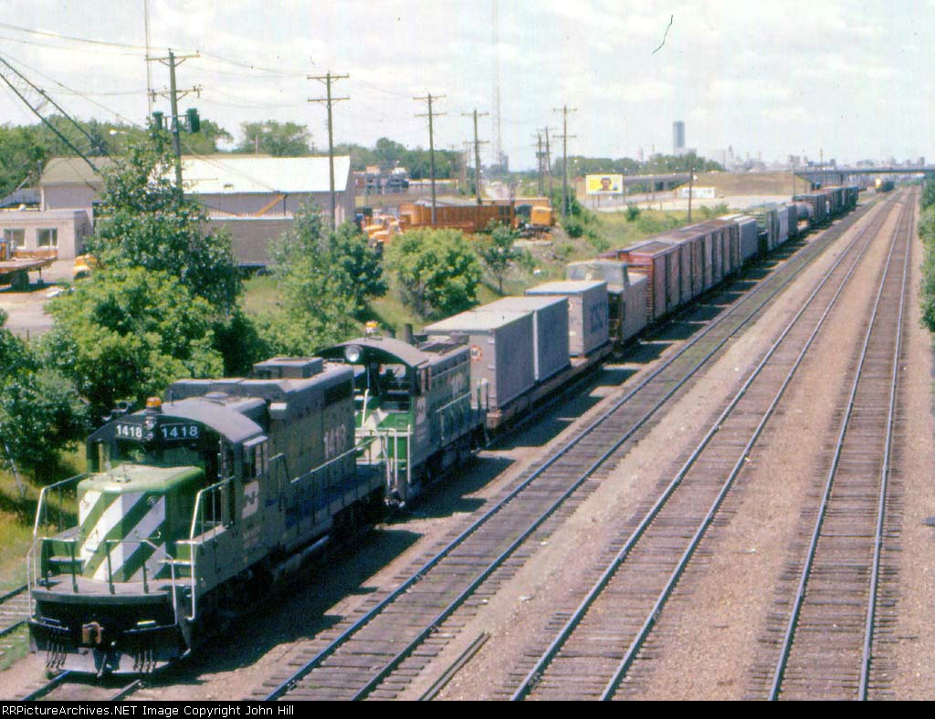 1010-04a Eastbound BN freight passing Koppers Coke