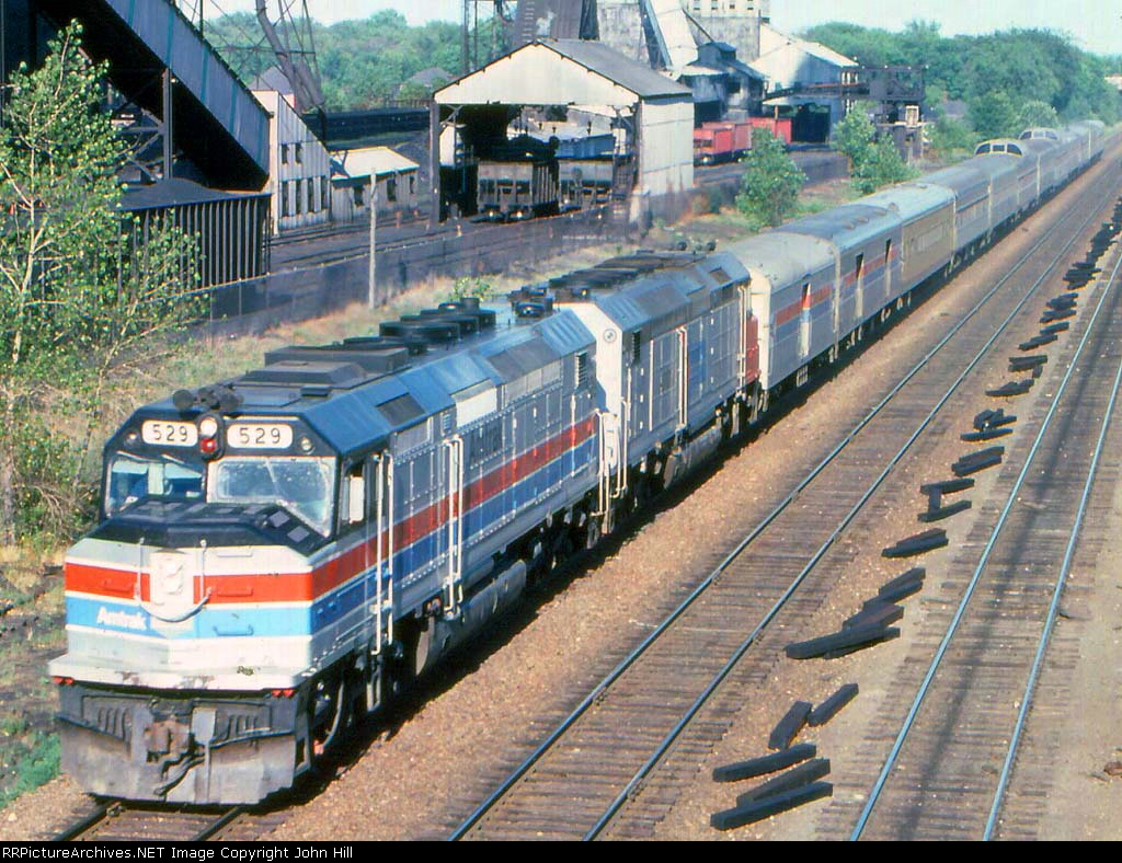 1012-34a Westbound Amtrak North Coast Hiawatha passing Koppers Coke