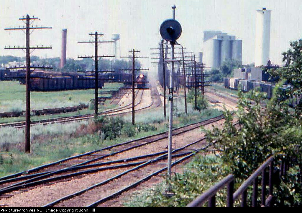 1014-23a Eastbound MILW freight passes Bass Lake Yard