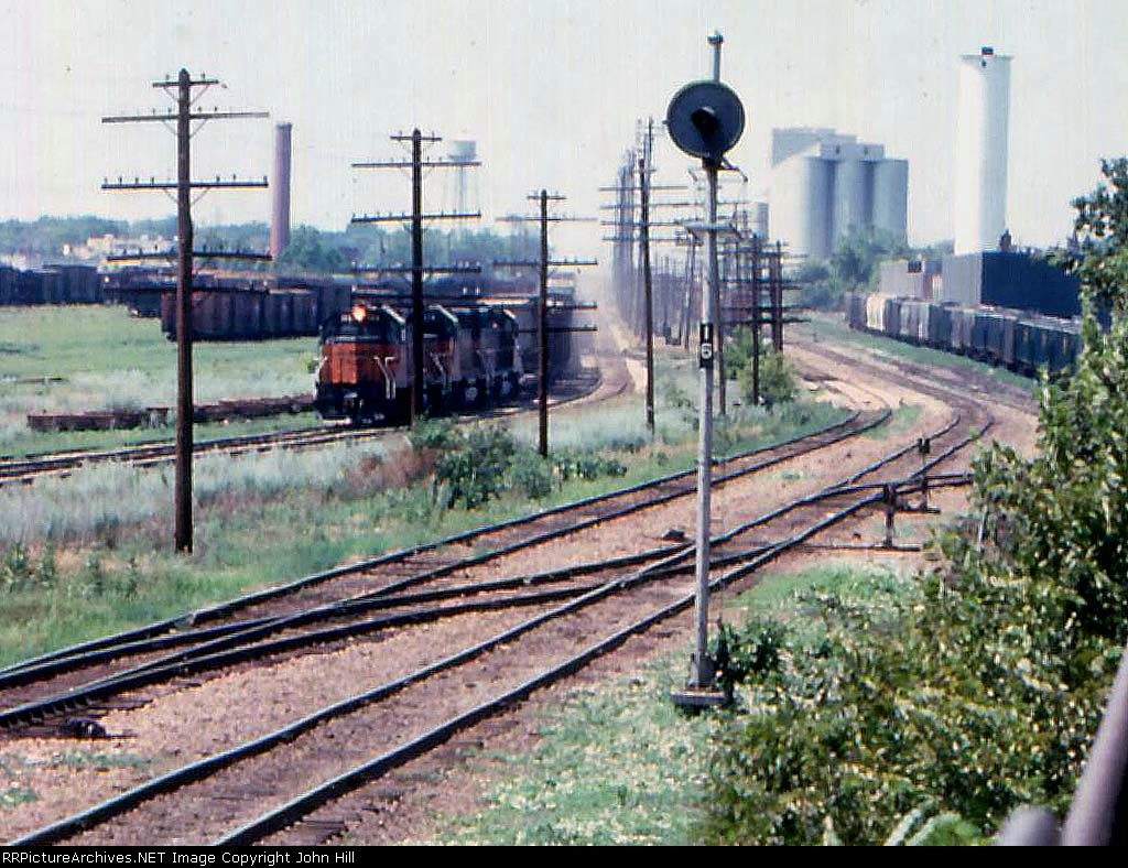 1014-24 Eastbound MILW freight passes Bass Lake Yard