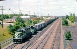 1010-04 Eastbound BN freight passing Koppers Coke