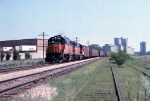 1014-19 Westbound MILW freight passes Bass Lake Yard & Burdick Elevators #1 & 2