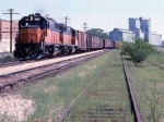 1014-19a Westbound MILW freight passes Bass Lake Yard & Burdick Elevators #1 & 2