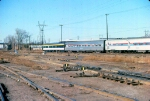 """1027-26 Eastbound Amtrak North Coast Hiawatha passes BN St. Anthony Jct. with PV """"Chapel Hill"""" on back"""