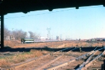 """1027-28 Eastbound Amtrak North Coast Hiawatha passes BN St. Anthony Jct. with PV """"Chapel Hill"""" on back"""