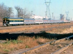 """1027-28a Eastbound Amtrak North Coast Hiawatha passes MN Transfer Raymond Ave Yard with PV """"Chapel Hill"""" on back"""