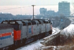 1032-18 Amtrak coach-only Twin City Hiawatha departs Mpls GN Depot to cross Stone Arch Bridge