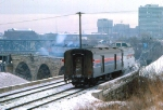 1032-20 Amtrak coach-only Twin City Hiawatha departs Mpls GN Depot to cross Stone Arch Bridge