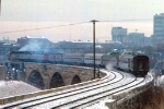 1032-21 Amtrak coach-only Twin City Hiawatha departs Mpls GN Depot to cross Stone Arch Bridge