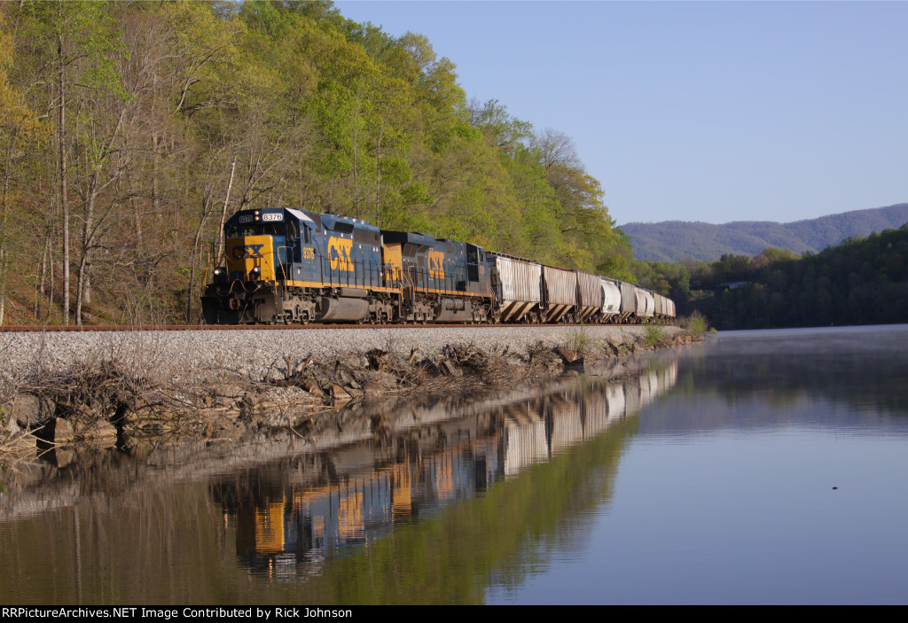 Lead by a standard cab SD40-2, this grain train is hugging the banks of the James River and will soon be looking at the East End of Reusens