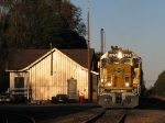 SCS 8795 backing past the depot in the last light of day