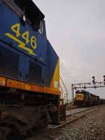 CSX 446, waits in the siding at Howell as CSX 8545, take a train east, after coming from a dead stop.