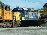 CSX 8158 in the shadow of another loco