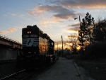 NS 5037 heading to the depot at sunset