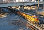BNSF 6003 leads a SB Herzog train as the shadows close in