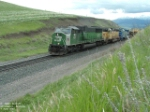 BNSF 9267 SD60M and green grass