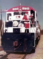 Santa Claus (with a strong resemblance to Manchester, GA based engineer John Douglas) exits the cab of U36B #1776 with a wave for the crowd