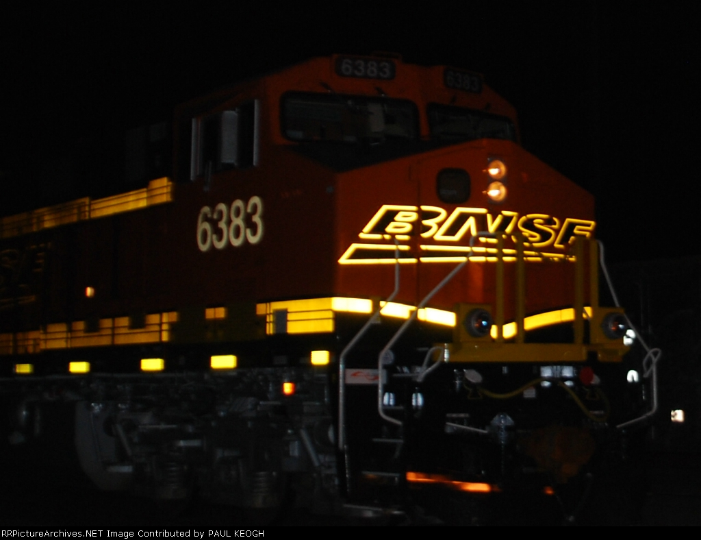 BNSF 6383 rolls south as a rear DPU unit on a loaded coal train with BNSF 6381 in front of her.