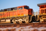 BNSF 6331 close up shot as she rolls north with a loaded coaltrain as the sun's rays reflect of her BNSF paint.