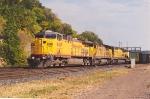 Loaded coal train exits yard for run uphill