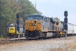 CSX ES-44AC #730 Takes a northbound out of the yard while CSX GP-38-2 #2803 waits to cross over & enter Collier Yard