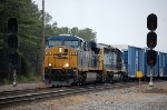 CSX ES-44AH #835 splits the signals with a northbound at Collier Yard