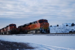 BNSF 6330 pushes a mty coal train south as she passes BNSF 5863 helper unit on this cold December am.
