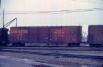 1126-35a CB&Q 47067 on eastbound C&NW transfer on BN passing Mpls GN Depot