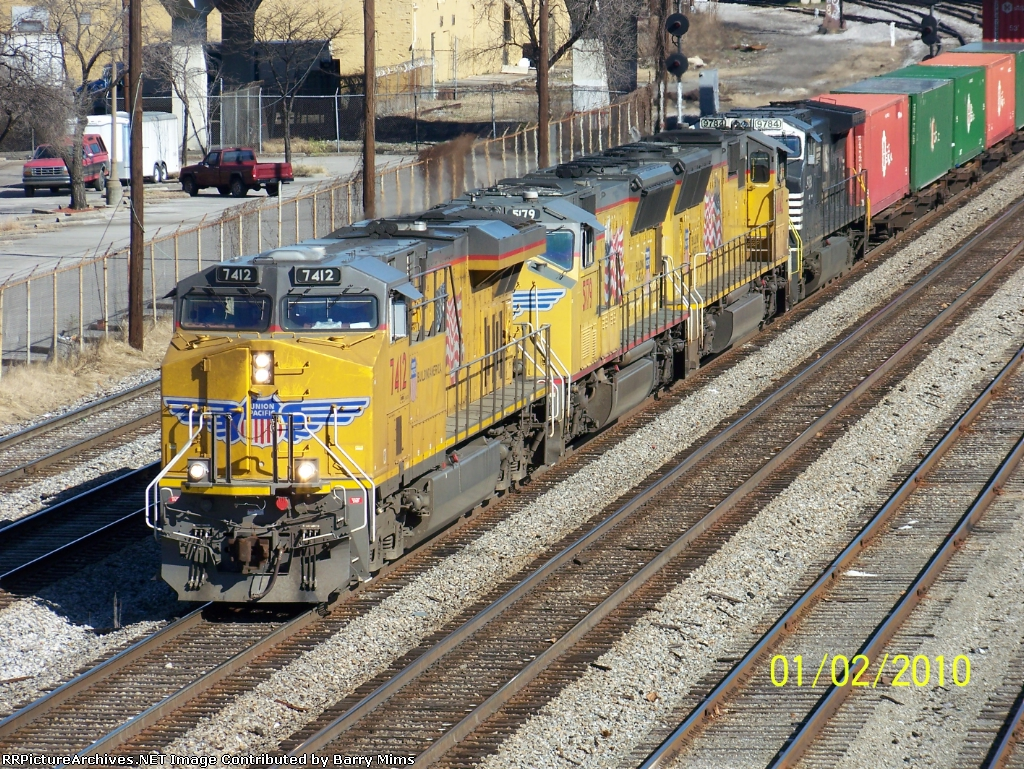 UP 7412 leads NS train 225