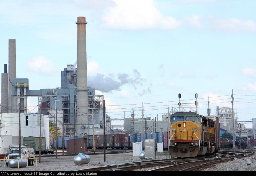 UP 8009, westbound NS train 145