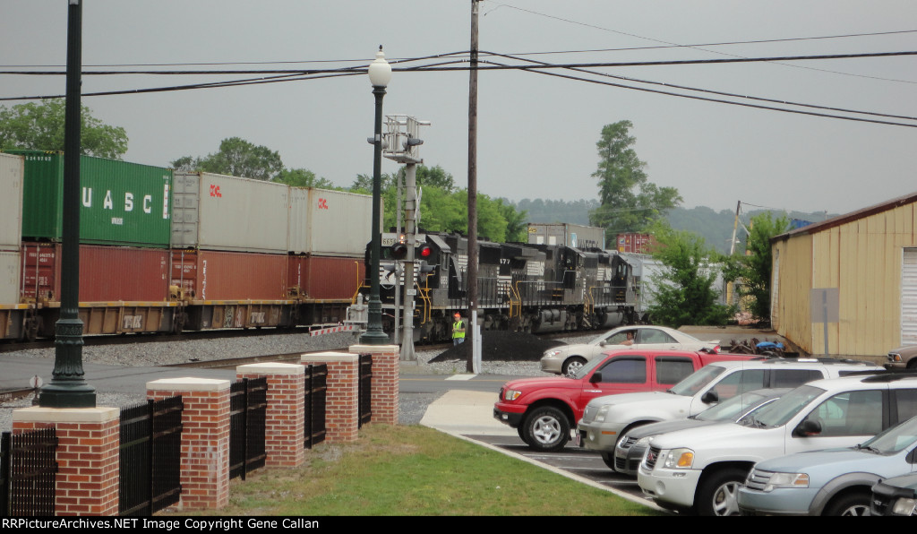 Conductor checks container train as it passes by