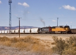 UP 2190 & HLCX 6336 move a solid hopper block toward Denver,
