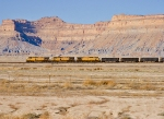 UP 6565, UP 6574 & UP 7219 hustle in front of the southeastern Utah Book Cliffs.