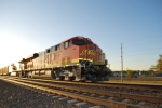 BNSF 6329 starts to gleem and glow in this combination sun and flash shot as she waits to go west with a loaded coal.