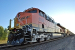 BNSF 6329 waits to roll west with a loaded coal train as the sun starts to rise behind her.