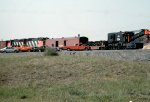 Canadian National GP40-2LW's 9574 & 9491, with wrecker #50014 and support cars #57711 & 57781 attempt to rerail passenger car #5060